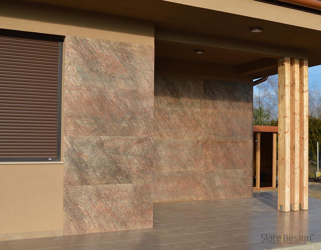 Szadai családi ház homlokzatburkolata kőből